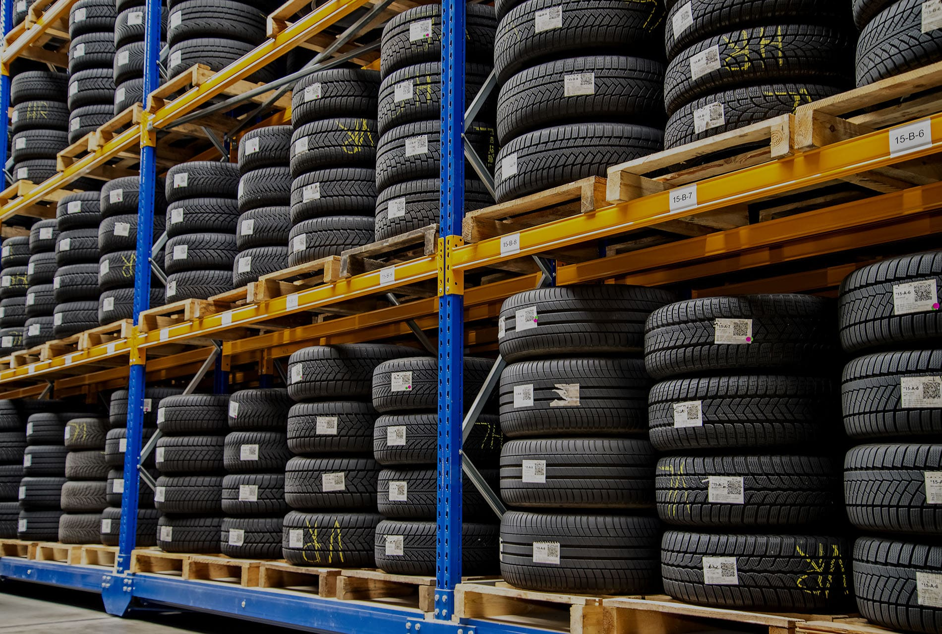 High rack with customer tires in a warehouse of a motor vehicle workshop